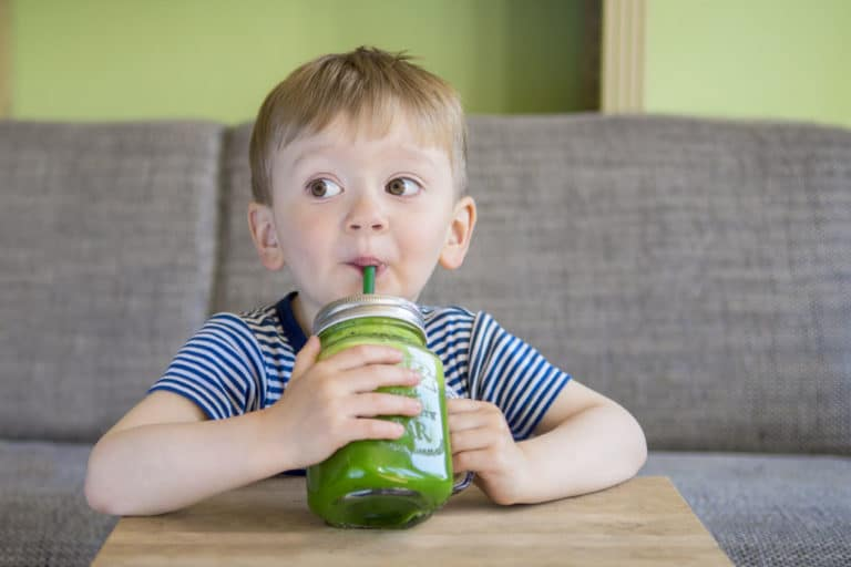Child Drinking a Green Juice