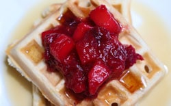cranberry apple compote on waffles